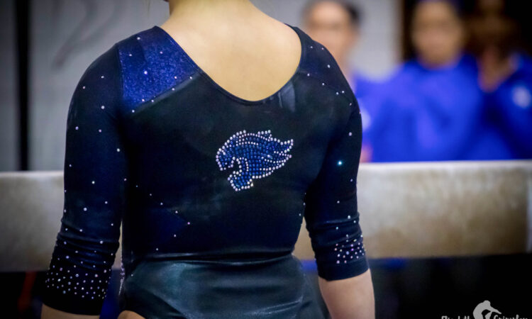 Kentucky gymnast before mounting the beam