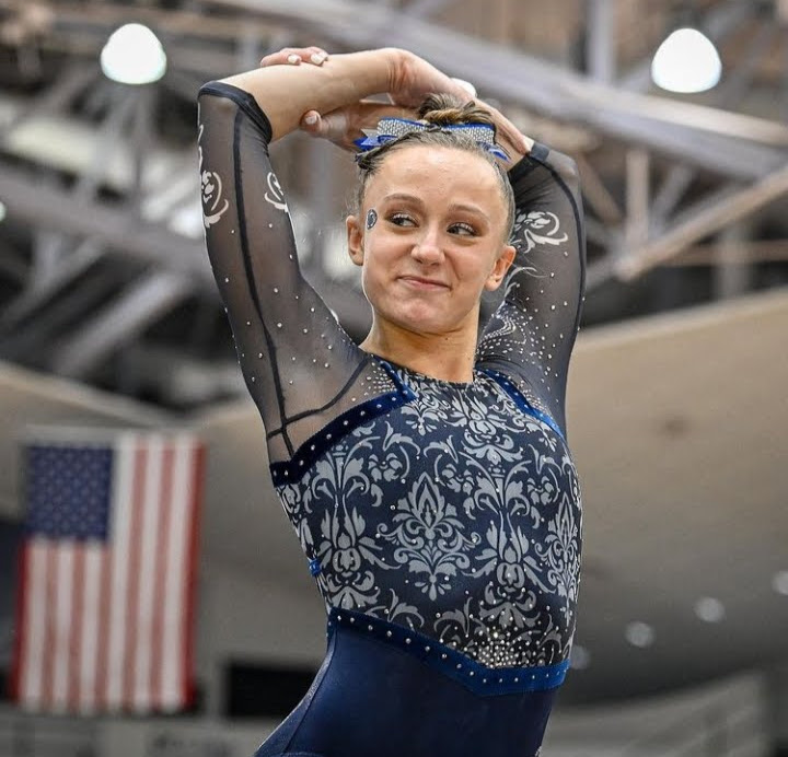 Cassidy Rushlow wears a bedazzled navy leo