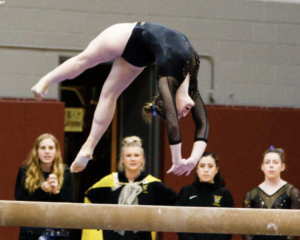 Gustavus Adolphus gymnast on beam